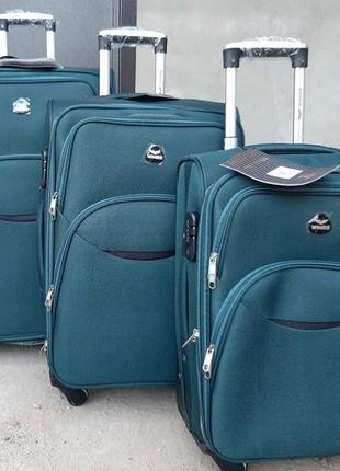 Тканевый дорожный чемодан wings 4 колеса