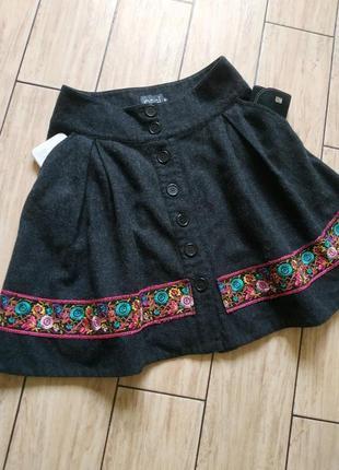 Теплая юбка с боковыми карманами на пуговицах