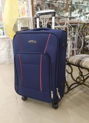 Маленький чемодан.чемодан на 4 колесах.