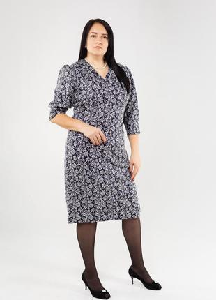Актуальное женское платье с карманами в больших размерах