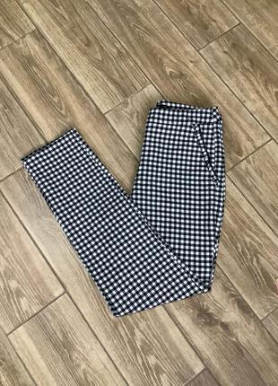 Стильные укороченные брюки zara в клетку  виши с боковыми карманами с рюшами .