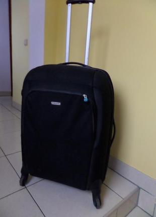 Samsonite велика валіза на 4 колесах