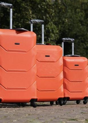 Помаранчева валіза від фірми wings 4 розміри