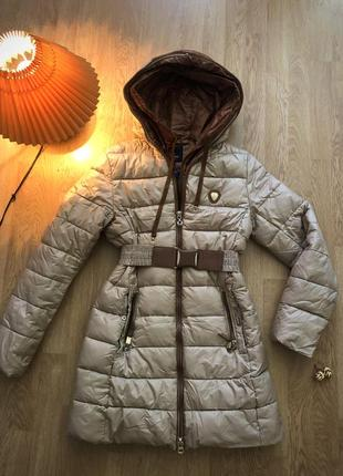 Кремово-бежева зимова куртка з ременем