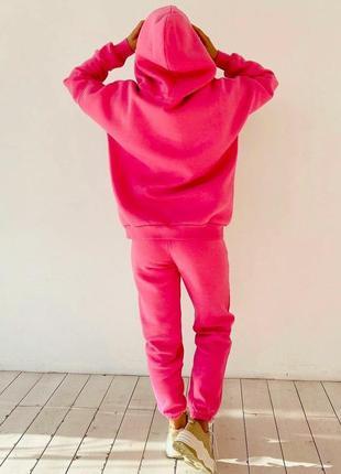 Спортивный костюм из трехнитки на флисе розового цвета