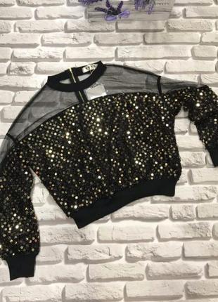 Женская модная блуза с паетками.