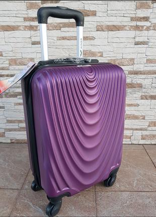 Дорожный чемодан фирмы wings  dark purple
