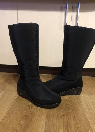 Високі теплі чобітки