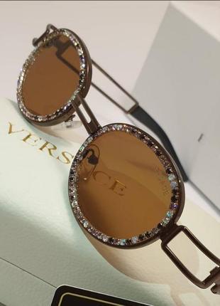 Стильные очки солнцезащитные в камнях разные цвета камни3 фото