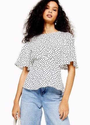 Жіноча блуза в горошок