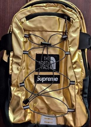 Золотой рюкзак tnf/supreme
