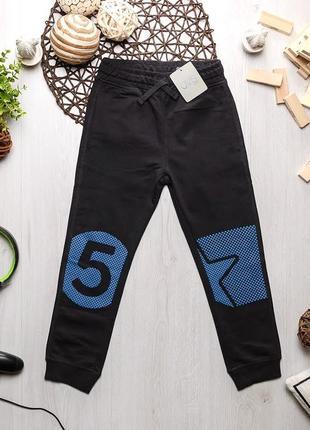 Серые трикотажные спортивные штаны для мальчика ovs kids италия