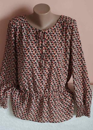 Стан нової!гарненька блузка р.42.