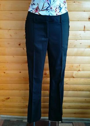 Оригинальные стильные брюки с декором по бокам гламурного немецкого бренда араrt.