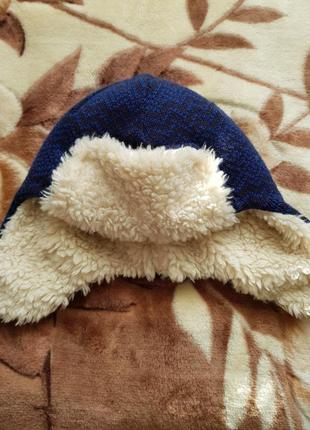 Теплая шапка-ушанка от columbia