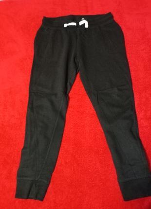 Спортивні чорні на манжетах утеплені штани h&m 84% котон