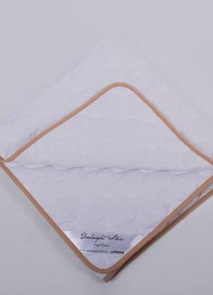Тепла гіпоалергена ковдра з шерсті мериносів розміром 140/100 см