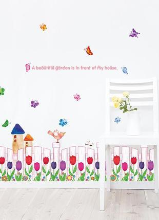 """Виниловая интерьерная наклейка на стену """"забор из тюльпанов и бабочки"""""""