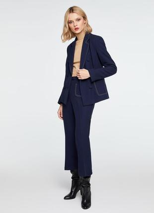 Стильний брючний костюм sisley. двобортний жакет. брюки с кишенями