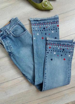 Супер джинси на гудзиках з вишивкою і бахромою на штанинах