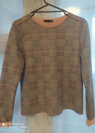 Блуза из ткани кожи