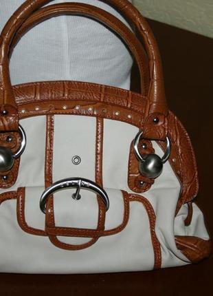 Женская стильная сумка оригинального фасона