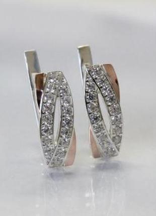 Серебренные серьги с золотыми вставками.