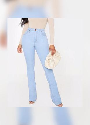 Світло-сині джинси-кльош