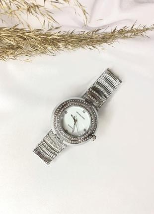 Жіночий годинник, женские часи