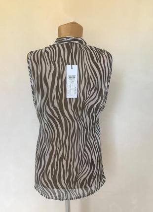 Шифоновая блуза без рукава в черно- белую полоску