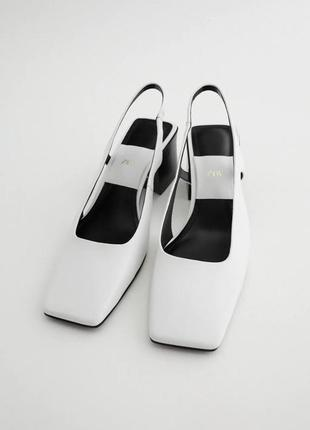 Белые кожаные туфли-мюли с открытой пяткой на каблуке  zara