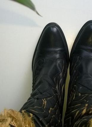 Женские кожанные сапоги бренда bogun.
