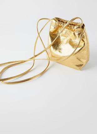 Золотая сумка zara
