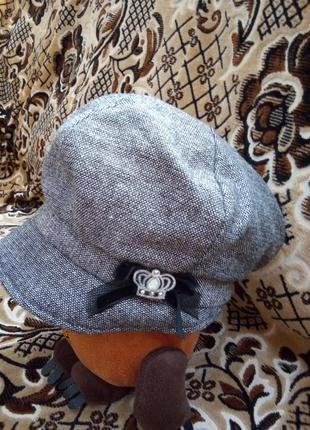 Дуже стильна і тепла брендова кепка !стан нової,ідеальний!