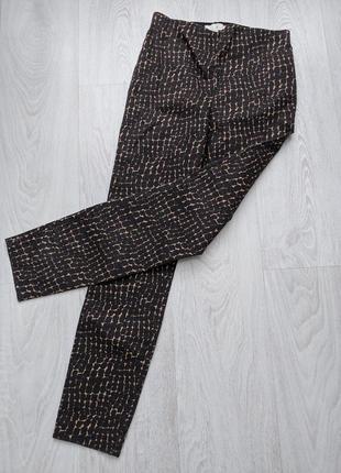 Стильные лосины штаны в змеиный принт