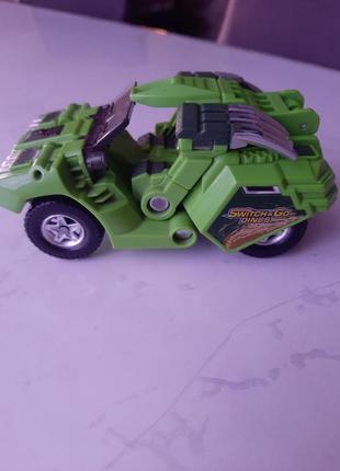 Динозавр робот трансформер
