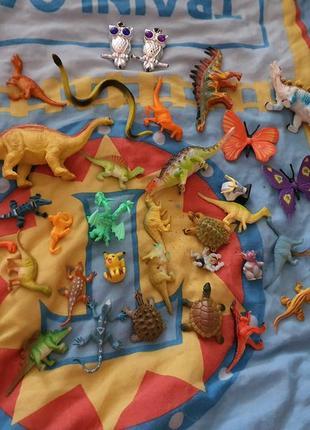 Игрушки комплектом динозавры