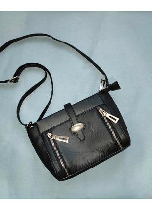 Чёрная сумка-клатч бренда tu