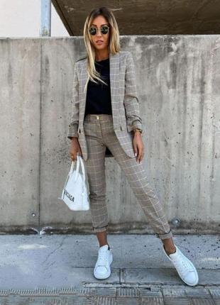 Костюм брючный пиджак+брюки в клетку.шикарного качества4 фото