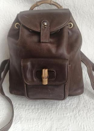 Винтажный кожаный рюкзак с бамбуковой ручкой от бренда gucci (италия) 100% оригинал.