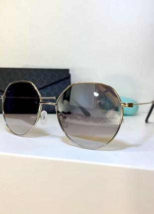 Серые солнцезащитные женские очки круглые