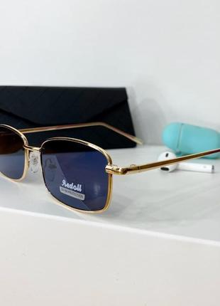 Синие солнцезащитные женские очки в тонкой оправе