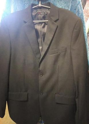 Мужской классический однобортный  пиджак чёрного цвета 50 р.