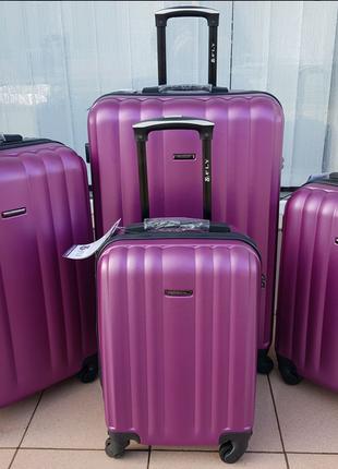 Дорожный чемодан фирмы fly на 4 колёсах бордовый