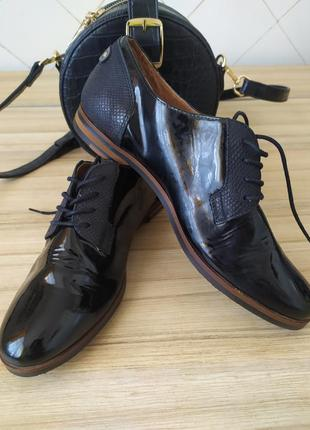 Германия.стильный брендовые кожанные туфли .р 39._40
