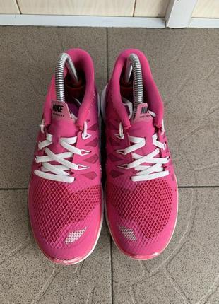 Рожеві кросівки nike free 5.0