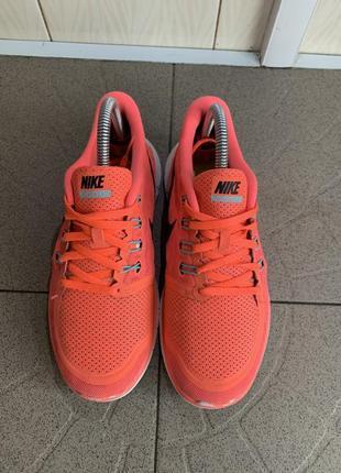 Оранжеві кросівки nike free 5.0