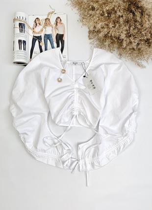 Нова блуза, затягується на грудях та рукавах, збоку є замочок