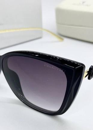 Swarovski очки женские солнцезащитные черные бабочки металические дужки