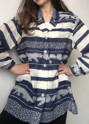 Симпатичная удлиненная блуза прямого кроя с леопардиками5 фото
